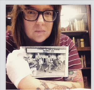 """Candace Hansen takes a """"selfie"""" while researching in the Justice for Janitors collections."""